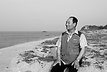 Kim Seong-do, who resides with his wife on disputed Dokdo Island, walks along the beaches near the East Sea Research Institute in Gyeongbuk, South Korea on 21 June 2010..Photographer: Robert GilhoolyKim Seong-do, who resides with his wife on disputed Dokdo Island, walks along the beaches near the East Sea Research Institute in Gyeongbuk, South Korea on 21 June 2010..Photographer: Robert Gilhooly