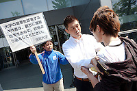 Hosei university security man-handle a student protester away during a Zengakuren student union demo at Hosei University Campus. Ichigaya, Tokyo, Japan. Friday April 25th 2014