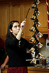 Waterbury, CT- 01 December 2016-120116CM04- Susanna Bennett of Cheshire strikes bells during a Christmas concert at the Middlebury Convalescent Home on Friday.  The Bennett family entertained the residents and staff at the home by playing classic tunes using various instruments.   Christopher Massa Republican-American