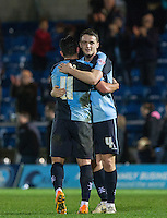 Stephen McGinn of Wycombe Wanderers embraces Sam Wood of Wycombe Wanderers on the final whistle during the Sky Bet League 2 match between Wycombe Wanderers and Crawley Town at Adams Park, High Wycombe, England on 28 December 2015. Photo by Andy Rowland / PRiME Media Images