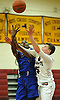 Rigaud Destime #3 of Copiague, left, tries to draw a foul on Matt Kleet #3 of Whitman during a Suffolk County varsity boys' basketball game at Whitman High School on Tuesday, Dec. 15, 2015. Copiague won by a score of 54-34.