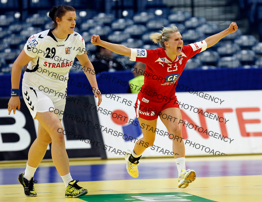 BELGRADE, SERBIA - DECEMBER 10: Ann Grete Norgaard (R) of Denmark celebrare the scores near Iveta Matouskova (L) of Czech republic during the Women's European Handball Championship 2012 Group I main round match between Czech Republic and Denmark at Arena Hall on December 10, 2012 in Belgrade, Serbia. (Photo by Srdjan Stevanovic/Getty Images)