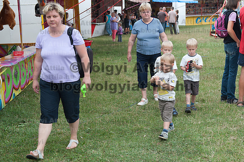 A family with triple twins participates the 12th Twin Festival held 7th time in Szigehalom (about 15 km from Budapest), Hungary on July 23, 2011. ATTILA VOLGYI