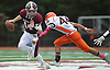 Colin Hart #14, Garden City quarterback, left, gets pressured by Mark Spano #44 of Carey before throwing for a short gain in the first quarter of a Nassau County Conference II varsity football game at Garden City High School on Saturday, Oct. 14, 2017.