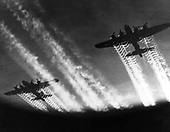 Vapor trails are left behind as Boeing B-17 Flying Fortresses fly over Europe. The B-17 prototype first flew on July 28, 1935. Few B-17s were in service on December 7, 1941, but production quickly accelerated. The aircraft served in every WW II combat zone, but is best known for daylight strategic bombing of German industrial targets. Production ended in May, 1945 and totaled 12,726 aircraft..Credit: U.S. Air Force via CNP