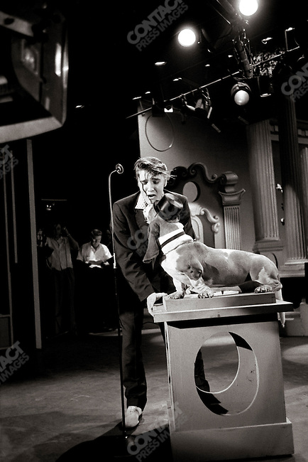 "The Steve Allen show, performing the ""Hound Dog"" song. The stage prop of a hound dog has nothing to do with the lyrics of the song which was much raunchier and sexier, and that the Allen show attempted to clean up by adding this stage prop of a dog; Hudson Theatre, NBC television, New York, USA, July 1st, 1956"