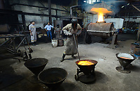 A furnace at f  Maria Dama plant burns getting raw gold in Antioquia department, Colombia. This is the first step to get pure gold, successive melting and chemical process are necessary to get the refined product