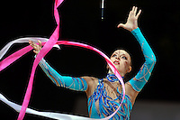 Vera Sessina of Russia recatches of ribbon during event finals at 2006 Thiais Grand Prix in Paris, France on March 26, 2006.  (Photo by Tom Theobald)