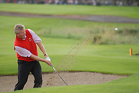 September 24th, 2006. European Ryder Cup team player Colin Montgomerie chips out of the bunker of the 17th green during the singles final session of the last day of the 2006 Ryder Cup at the K Club in Straffan,. County Kildare in the Republic of Ireland...Photo: Eoin Clarke/ Newsfile..