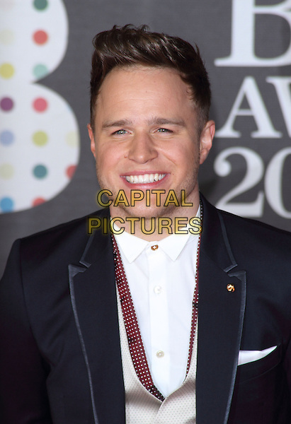 Olly Murs.Arrivals for The 2013 Brit Awards at the O2 Arena, London, England..February 20th 2013.BRITS portrait headshot white shirt gold button smiling .CAP/ROS.©Steve Ross/Capital Pictures