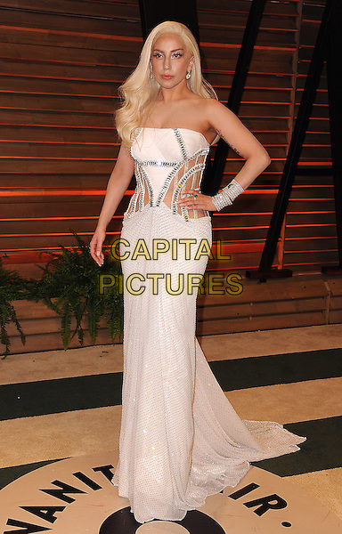 WEST HOLLYWOOD, CA - MARCH 2: Lady Gaga (Stefani Joanne Angelina Germanotta) arrives at the 2014 Vanity Fair Oscar Party in West Hollywood, California on March 2, 2014.  <br /> CAP/MPI/MPI213<br /> &copy;MPI213/MediaPunch/Capital Pictures