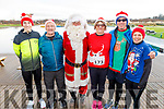 Derek Griffin (Tralee), George Glover, Santa, Joan Glover (Ballymac), Mike and Rose Brosnan (Ballymac) at the Fiona Moore Memorial 5k Fun Run in the Tralee Bay Wetlands on Sunday morning.