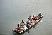 Aldeia Baú, Para State, Brazil. Group of women in a boat on a babassu collecting trip.