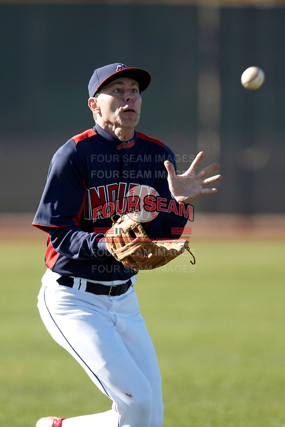 Cleveland Indians Fantasy Camp member catches a fly ball during a game at Goodyear Training Complex on January 19, 2012 in Goodyear, Arizona.  (Mike Janes/Four Seam Images)