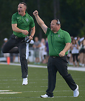NWA Democrat-Gazette/ANDY SHUPE<br /> New Van Buren coach and former Arkansas quarterback Casey Dick (left) celebrates Tuesday, Aug. 28, 2018, alongside defensive line coach Chris Elliott after a score against Alma during the first half at Airedale Stadium in Alma. Visit nwadg.com/photos to see more photographs from the game.