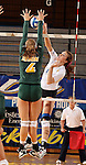 BROOKINGS, SD - OCTOBER 26:  Emily Veldman #12 from South Dakota State tries for a kill past Dani DeGagne #4 from North Dakota State in the first game of their match Saturday evening at Frost Arena in Brookings. (Photo by Dave Eggen/Inertia)