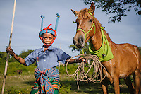 Portrait of a young Pasola warrior from Tosi, Kodi. Pasola is an ancient tradition from the Indonesian island of Sumba. Categorized as both extreme traditional sport and ritual, Pasola is an annual mock horse warfare performed in response to the harvesting season. In the battelfield, the Pasola warriors use blunt spears as their weapon. However, fatal accident still do occurs.