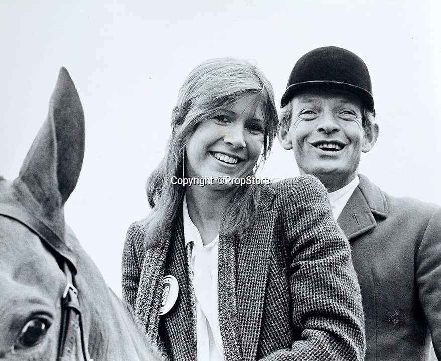 BNPS.co.uk (01202 558833)<br /> Pic: PropStore/BNPS<br /> <br /> Carrie Fisher with the Grafton Hunt at the event in rural Northamptonshire in 1978.<br /> <br /> A Stormtrooper helmet from the first Star Wars film has sold for almost £200,000 by a relative of a British country squire.<br /> <br /> Captain Robert Hawkins and his wife Anne were gifted the iconic helmet for staging the Star Wars Cross Country Team Event at their English manor house in 1978.<br /> <br /> The bizarre equestrian event was attended by Carrie Fisher, who played Princess Leia, Darth Vader actor David Prowse, Peter Mayhew, who played Chewbacca, and football pundit Jimmy Hill.