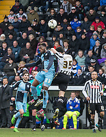 Gozie Ugwu of Wycombe Wanderers beats Mike Edwards of Notts County in the air during the Sky Bet League 2 match between Notts County and Wycombe Wanderers at Meadow Lane, Nottingham, England on 28 March 2016. Photo by Andy Rowland.