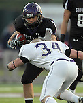 ROME, GA - DECEMBER 18: Kristian Porter #36 of the University of Sioux Falls tries to shake the tackle of Brian Strobel #34 from Carroll College in the first quarter at Barron Stadium in the 2010 NAIA National Football Championship in Rome, GA.(photo by Dave Eggen/Inertia)