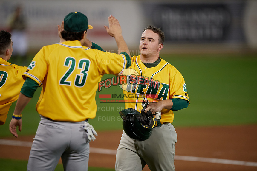 Siena Saints Alex Milone (10) high fives Nick Melillo (23) during a game against the UCF Knights on February 14, 2020 at John Euliano Park in Orlando, Florida.  UCF defeated Siena 2-1.  (Mike Janes/Four Seam Images)