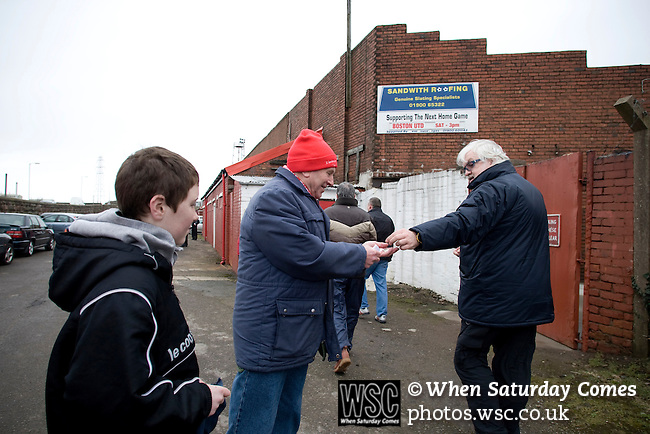 Workington AFC 0 Boston United 1, 24/02/2008. Borough Park, Blue Square North.  A home supporter selling 'golden goal' tickets prior to the Blue Square North fixture between hosts Workington AFC (red) and Boston United at Borough Park. The visitors won with a solitary sixth-minute goal by Jon Rowan in front of 388 spectators. Both Workington AFC and Boston United were members of the Football League, the Cumbrians losing League status in 1977 while the Lincolnshire club were relegated in 2007 and demoted two divisions for financial irregularities. Photo by Colin McPherson.