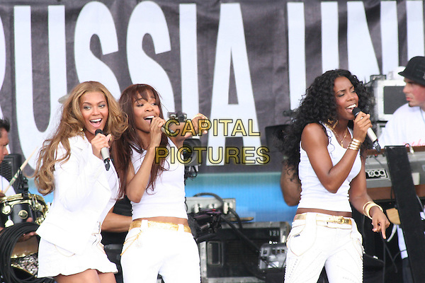 DESTINY'S CHILD - .BEYONCE KNOWLES, MICHELLE WILLIAMS & KELLY ROWLAND .Perfom at Live 8 Philadelphia - A concert to raise awareness for an end to extreme poverty in Africa (Make Poverty History) ahead of the G8 Summit taking place later this week. .Philadelphia Museum of Art, Philadelphia, .Pennsylvania, USA, July 2nd 2005..half length gig makepovertyhistory live8 aid white jacket short mini skirt .Ref: IW.www.capitalpictures.com.sales@capitalpictures.com.©Ian Wilson/Capital Pictures.