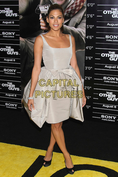 "EVA MENDES .The World Premiere of ""The Other Guys"" at the Ziegfeld Theater, New York, NY, USA..August 2nd, 2010.full length dress grey gray silver bow sash pleats pleated black peep toe shoes sleeveless .CAP/LNC/TOM.©TOM/LNC/Capital Pictures."