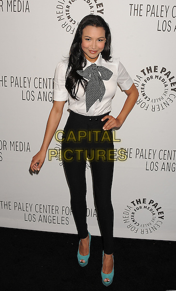 "NAYA RIVERA.The PaleyFest for ""Glee"" at the Saban Theatre in The Paley Center for Media in Beverly Hills, California, USA..March 16th, 2011.full length skinny thin high waisted jeans jeggings black white shirt bow tie polka dot turquoise peep toe shoes wedges suede platform tattoo on ankle .CAP/ROT/TM.© TM/Roth/Capital Pictures"