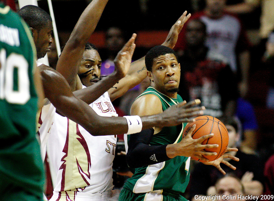 TALLAHASSEE, FL 11/16/09-FSU-JU BB09 CH44-Florida State's Solomon Alabi, left and Ryan Reid box in Jacksonville's Lehmon Colbert during half action Monday at the Donald L. Tucker Center in Tallahassee...COLIN HACKLEY PHOTO