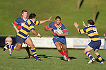 Vince Fatu goes for the gap between Male Sau' & Kane Hancy. McNamara Cup final - Premier 1 Championship, Patumahoe v Ardmore Marist. Patumahoe won 13 - 6. Counties Manukau club rugby finals played at Growers Stadium, Pukekohe, 24th of June 2006.