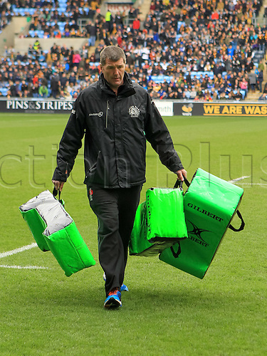 09.04.2016. Ricoh Arena, Coventry, England. European Champions Cup. Wasps versus Exeter Chiefs.  Exeter's Director of Rugby clears away the tackle-bags after team warm-up.