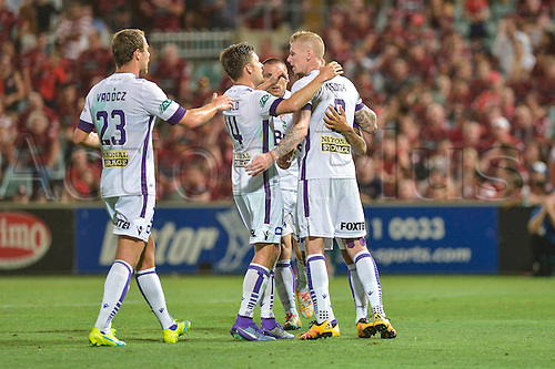 26.02.2016. Pirtek Stadium, Parramatta, Australia. Hyundai A-League. Western Sydney Wanderers versus Perth Glory. Perth forward Andy Keogh scores the penalty and his team mates congratulate him. The Wanderers won 2-1.