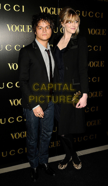 JAMIE CULLUM & SOPHIE DAHL.A dinner in honour of Frida Gianni, Creative Director of Gucci, hosted by Alexandra Shulmanand at the Saatchi Gallery, Duke of York's Headquarters, King's Road, Chelsea, London, England..April 1st, 2009 .Vogue full length black coat dress leopard print shoes ballet flats pumps clutch bag suit jacket jeans denim couple jaime gold .CAP/CAN.©Can Nguyen/Capital Pictures.