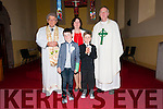 Scoil Mhaolchéadair pupils Aodhna Ó Beaglaoi and Aidan Ó Murchú the day of their First Communion, here pictured with their muinteoir Mai Uí Bhruic, an tAthair Eoghan Ó Cadhla and an tAthair Tomas Ó hÍceadha, at Saipéal na Carraige on Saturday.