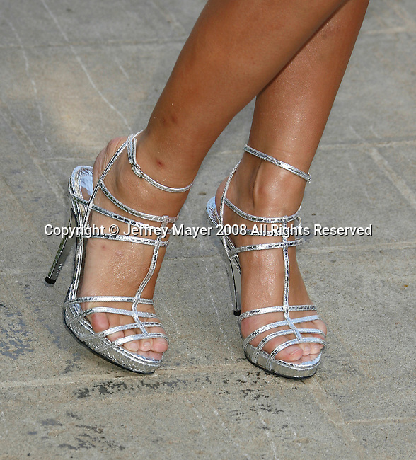 """Holly Madison arrives at the Much Love Animal Rescue Presents The Second Annual """"Bow Wow WOW!"""" at The Playboy Mansion on July 19, 2008 in Beverly Hills, California."""