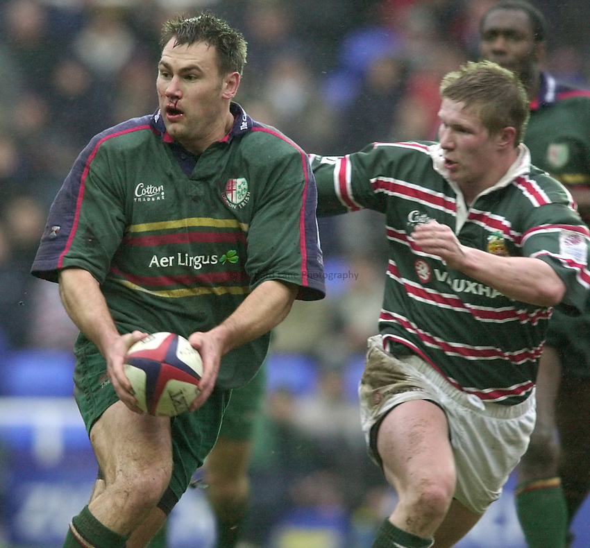 Photo. Richard Lane. .London Irish v Leicester. Zurich Premiership. 10/2/2001.Jason Wright moves the ball out as Ollie Smith tackles.
