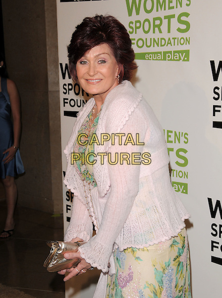 SHARON OSBOURNE .The Women's Sports Foundation presentation of The Billies held at The Beverly Hills Hotel in Beverly Hills, California, USA..April 15th, 2008   .half length pink cardigan gold clutch bag .CAP/DVS.©Debbie VanStory/Capital Pictures.