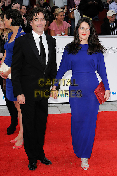 STEPHEN MANGAN & LOUISE DELAMERE .Attending the Philips British Academy Television Awards, Grosvenor house Hotel, Park Lane, London, England, UK, May 22nd 2011..arrivals TV Baftas Bafta full length black suit tie blue dress long sleeve holding hands  red clutch bag .CAP/CAN.©Can Nguyen/Capital Pictures.