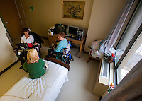 Kara visits a client in a nursing home to discuss options for finding an independant living arrangement with the help of Arise. Photo by James R. Evans ©