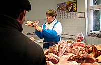 A butcher sells meat in a shop in Murmansk, the world's largest Arctic city. /Felix Features