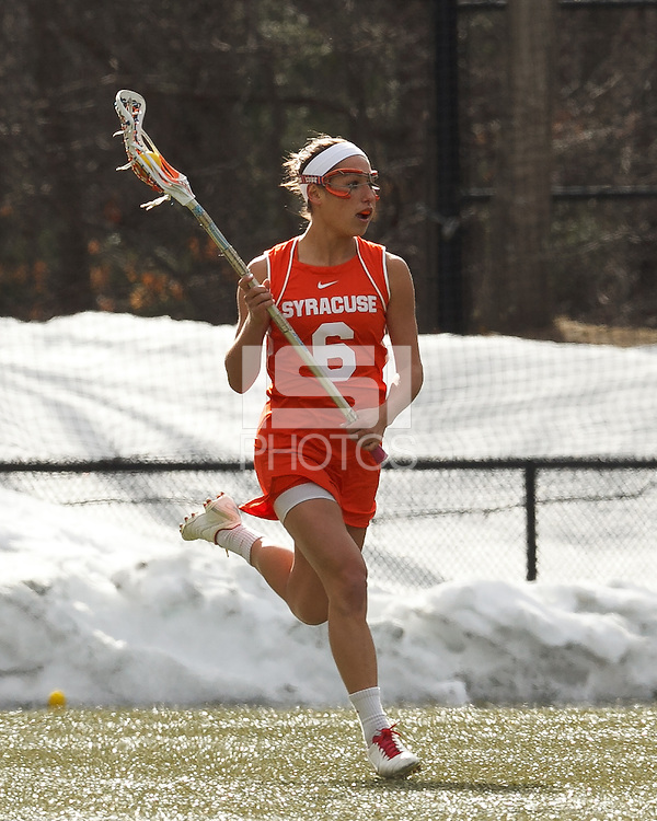 Syracuse University defender Natalie Glanell (6) brings the ball forward.   Syracuse University (orange) defeated Boston College (white), 17-12, on the Newton Campus Lacrosse Field at Boston College, on March 27, 2013.