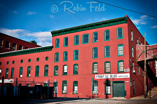 Front Street Building showing the north side. This old industrial building painted red with green trim creates a striking view - just east of Downtown Dayton