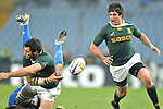 Danie Rossouw of South Africa (left) gives the ball to a team mate after having been tackled during a rugby test match between Italy and South Africa in Udine, Italy on November 21, 2009.