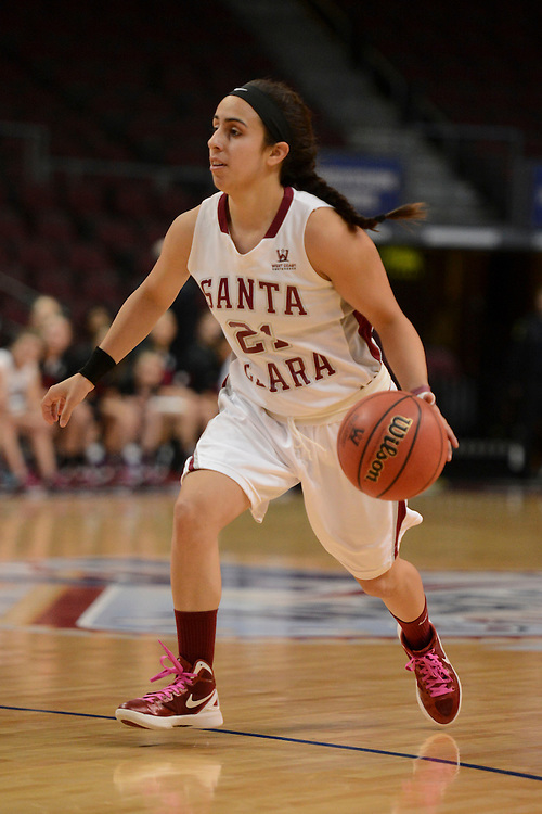 March 6, 2014; Las Vegas, NV, USA; Santa Clara Broncos guard Raquel Avila (21) dribbles against the Pepperdine Waves during the first half of the WCC Basketball Championships at Orleans Arena. The Waves defeated the Broncos 80-74.