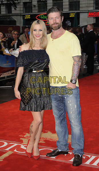 Jessica-Jane Clement & Lee Stafford.The 'Chariots Of Fire' UK film premiere, Empire cinema, Leicester Square, London, England..July 10th, 2012.full length black dress off the shoulder lace red shoes tattoo yellow t-shirt jeans denim couple .CAP/CAN.©Can Nguyen/Capital Pictures.