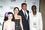 Actress Lilla Crawford, actress Emilia Clarke, HBO CEO Richard Plepler, and actor Michael K. Williams  attending the 2013 Actors Fund Annual Gala at the Mariott Marquis Hotel in New York on 4/29/2013...