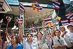 Apr. 19 2010 - BANGKOK, THAILAND: Workers in the Silom financial district have an anti-Red Shirt rally Monday afternoon. Hundreds of Thai soldiers, including reservists and front line units, and riot police moved into the Silom financial district Monday, not far from the red-shirts' main protest rally site, in Ratchaprasong. The heavy show of force is to prevent the Red Shirts from entering the Silom area. Many of soldiers were greeted as heros by workers in the area, who oppose the Red Shirts.   Photo by Jack Kurtz