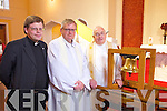 Fr Bernard Healy from Dingle, Tarbert Parish Priest Fr John O'Connell and Tarbert native Fr Danny Broderick pictured here last Wednesday afternoon with the Eucharistic Congress Bell which is touring parishes in Ireland as part of the International Eucharistic Congress 2012.