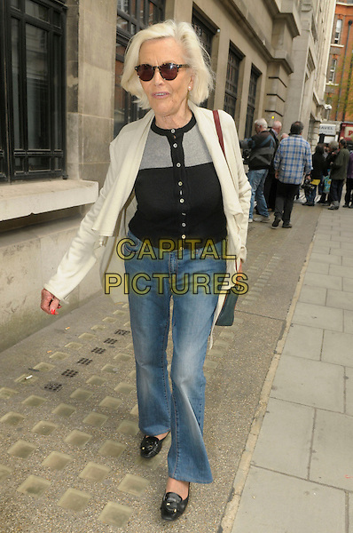 Honor Blackman.leaving BBC Radio 2 London, England, UK, .25th April 2013..full length sunglasses jeans cream cardigan black top buttons loafers walking bag .CAP/IA.©Ian Allis/Capital Pictures.